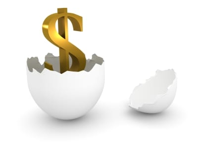 Dollar sgn hatching out of an egg
